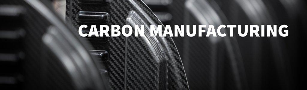 """Carbonschalen im Hintergrund mit Überschrift """"Carbon Manufacturing"""""""